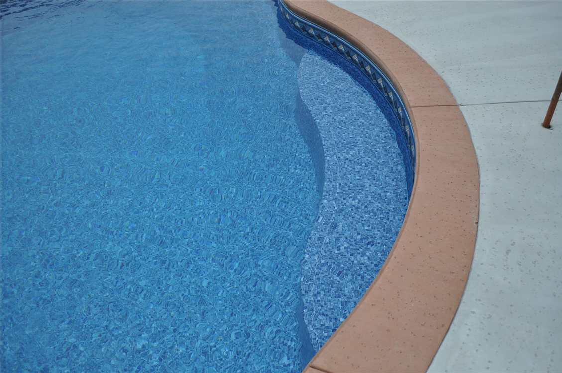 Countoured In-pool Bench Seat, Colored Concrete Coping with Salt Treatment