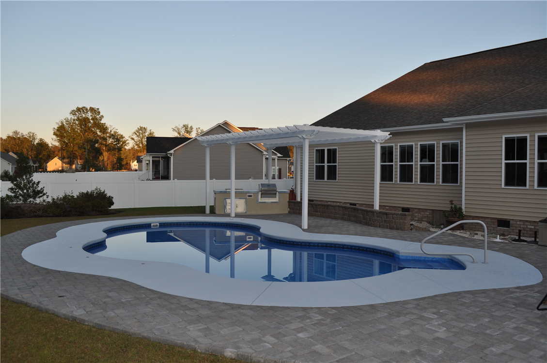 Oasis pool with Pergola and Outdoor Kitchen