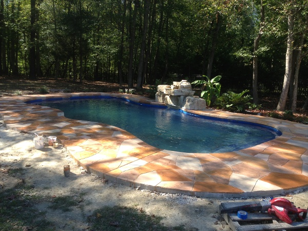 with Rico Rock Waterfall and Faux Stone Decking