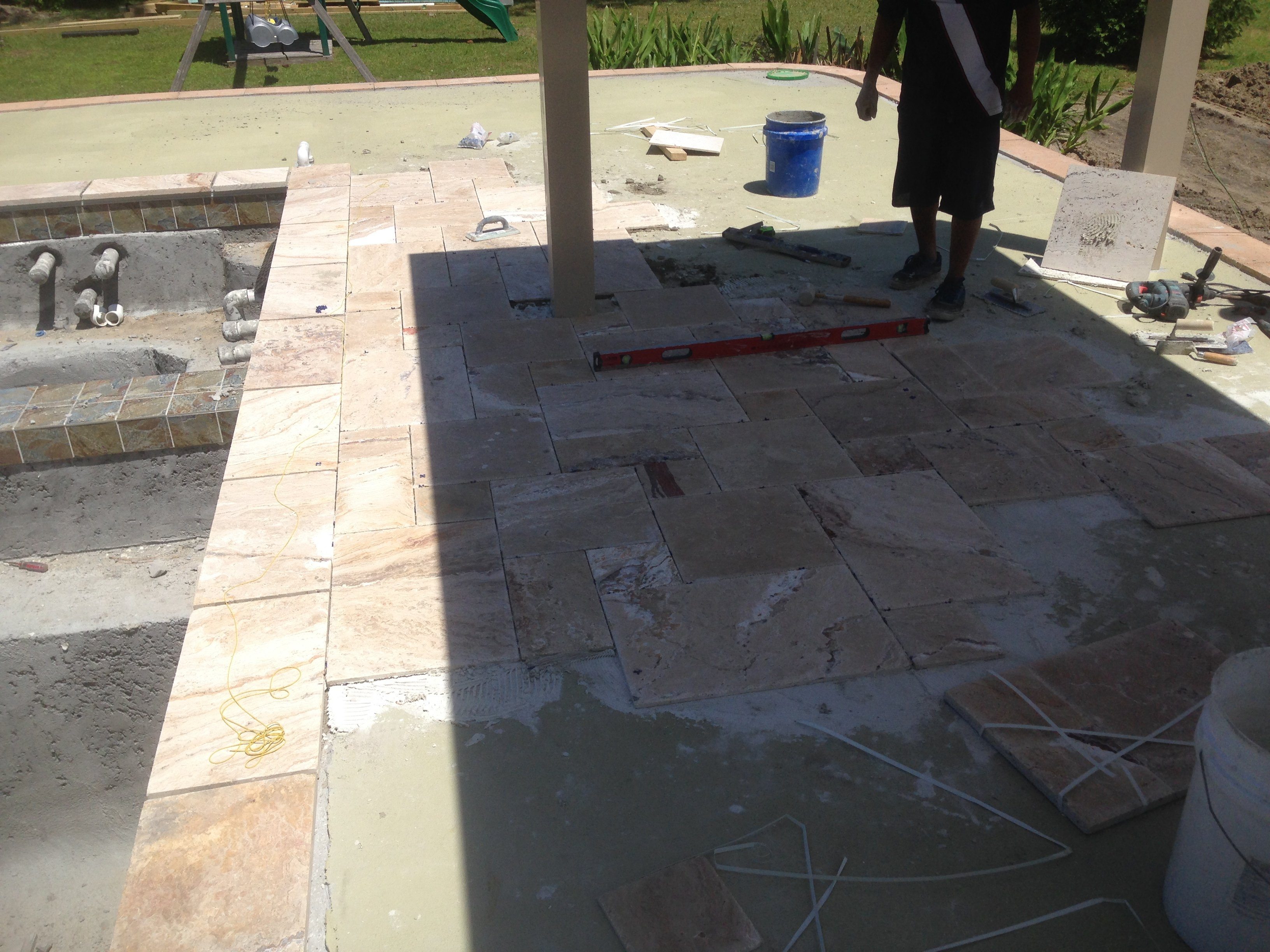 Swimming pool renovations commercial and residential installing beautiful travertine tile over concrete deck with crack barrier dailygadgetfo Choice Image