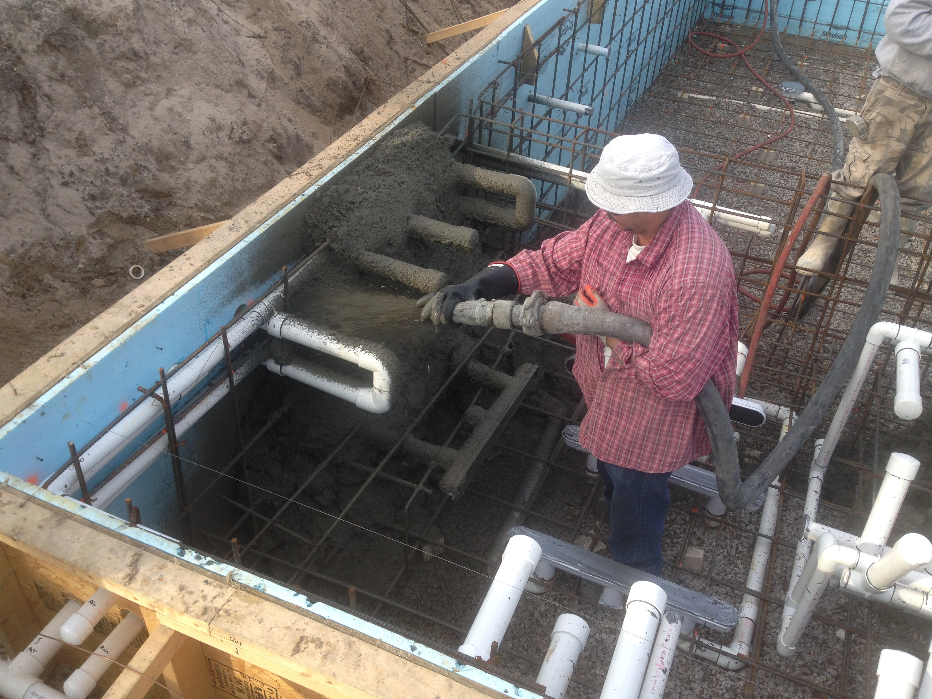 #4 steel rebar and plumbing is in place. Applying 4,000 PSI Concrete with Shotcrete Process