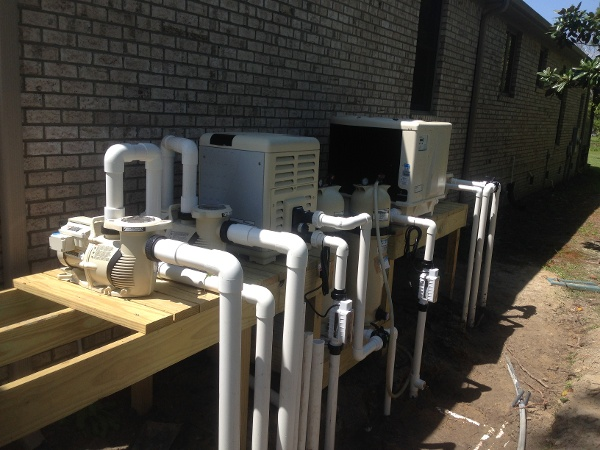 Two Variable Speed Pumps for Hot Tub, One single speed 1/2 hp pump for pool, One Propane heater for hot tub, one Electric Heat Pump for pool, Two cartridge filters