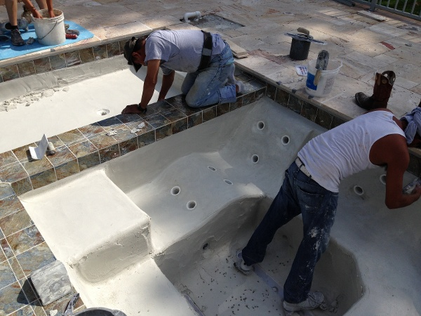 Tile is installed and time to Plaster the pool and hot tub
