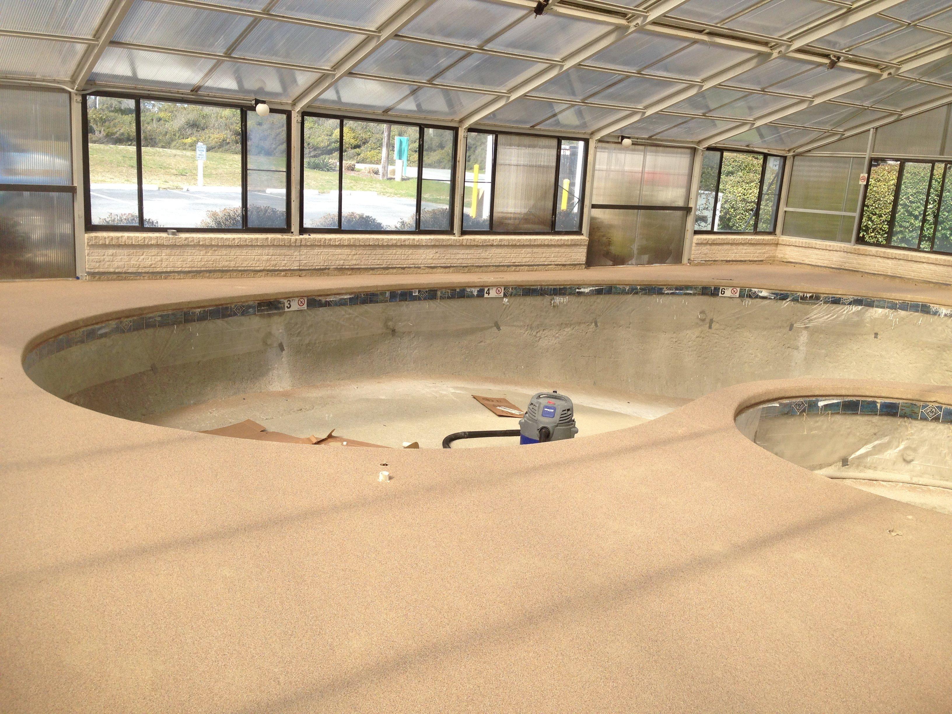 Applying Rubber Based Quartz Decking, New Waterline tile is installed